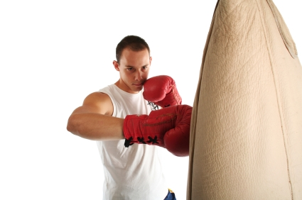 Boxing Gloves - impacting bag